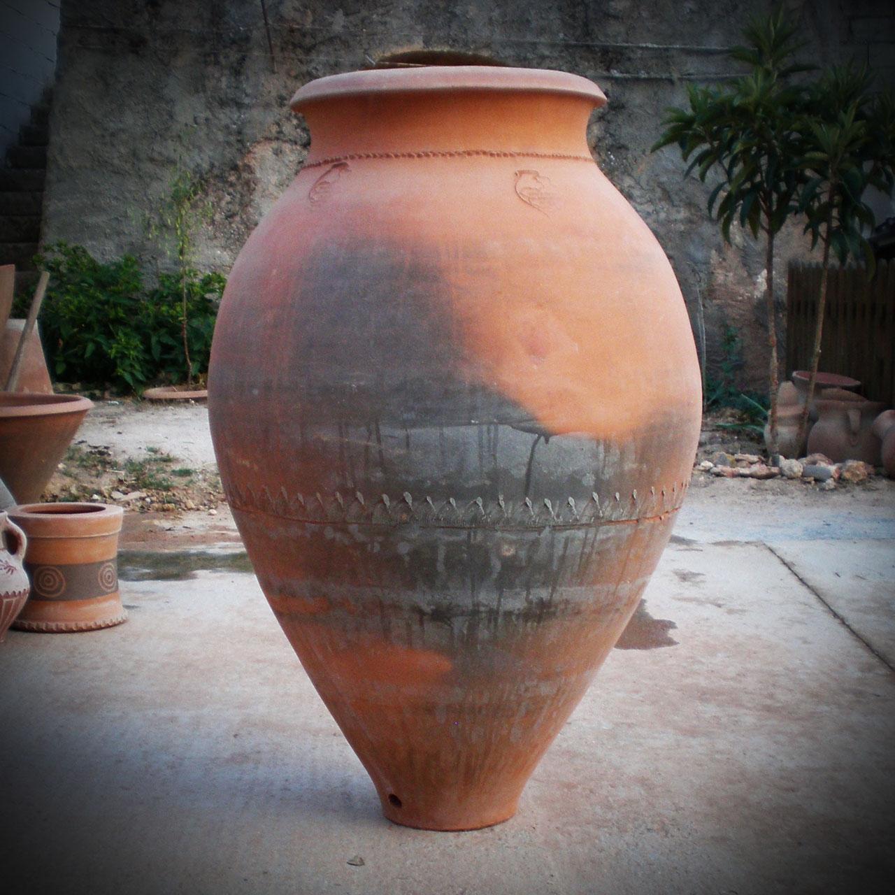 Opiniones de tinaja for Tinajas de barro para jardin